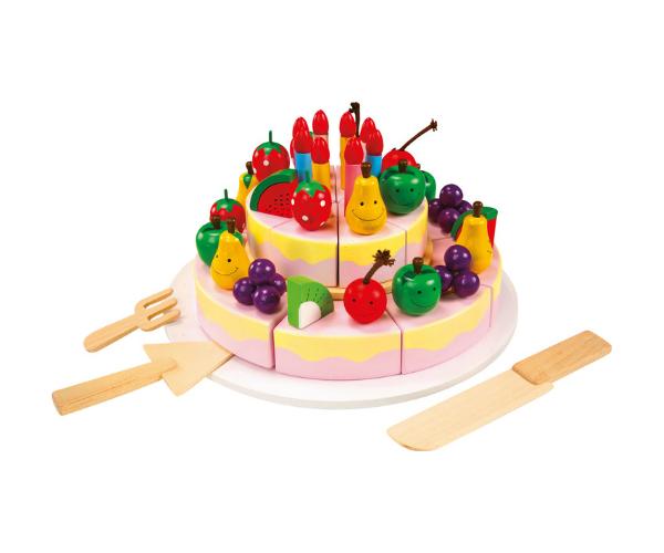 Puidust sünnipäevatort puuviljade ja küünaldega